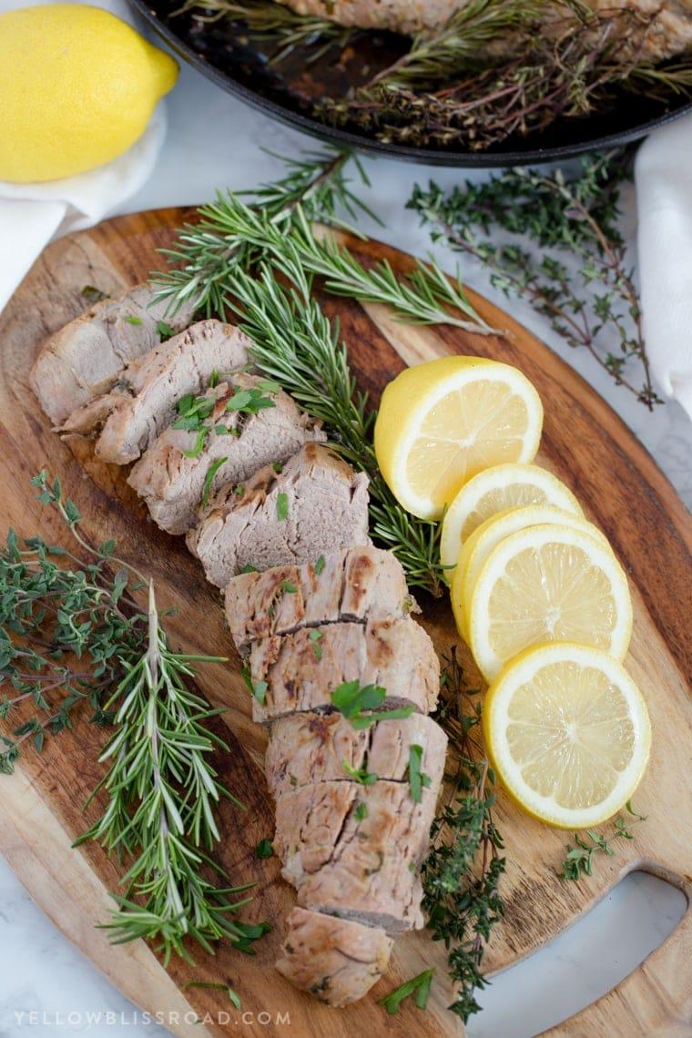 Sliced pork tenderloin on a cutting board