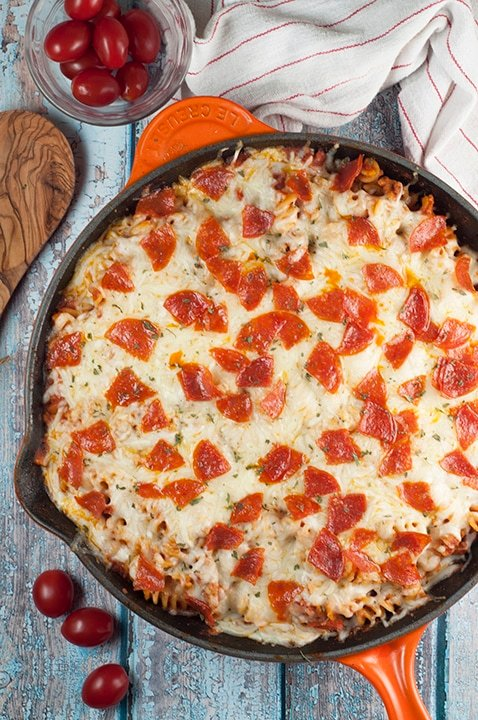 A pan filled with pasta, cheese, and pepperoni