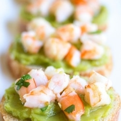 Guacamole Shrimp Bruschetta is an easy, 10-minute appetizer that's full of flavor and perfect for parties!