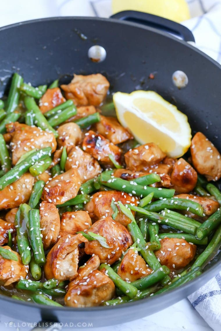 Honey Lemon Chicken and Green Beans Stir fry in a skillet.