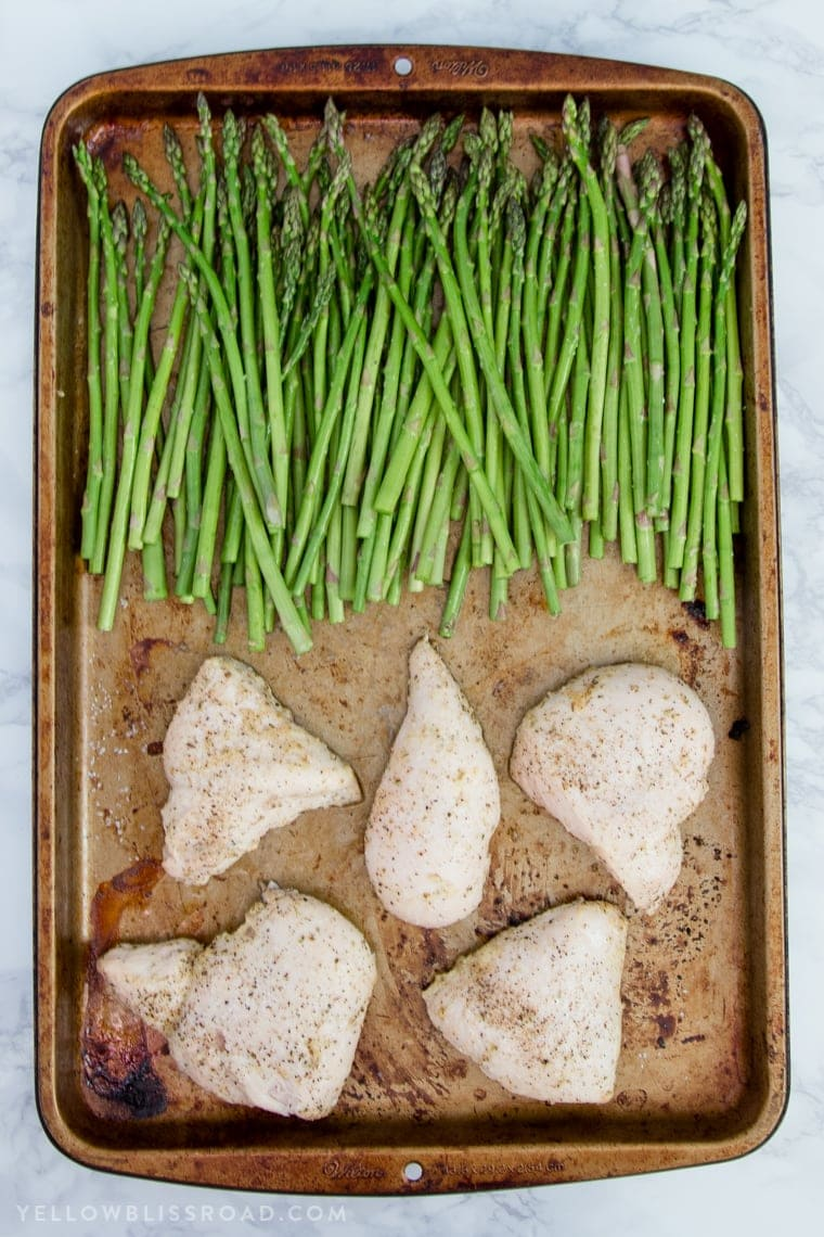 This Lemon Herb Chicken & Asparagus Sheet Pan Dinner is a delicious and healthy one pan meal that is perfect for busy weeknights!