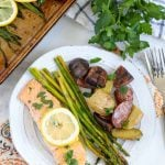 A plate of salmon, potatoes and asparagus on a table