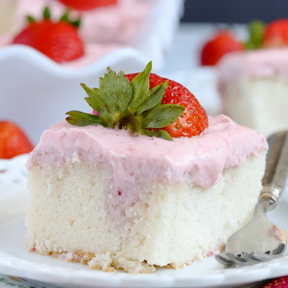 This Strawberries and Cream Poke Cake takes full advantage of Strawberry season with tons of fresh strawberries in the filling and the frosting. It's a strawberry lovers dream dessert!