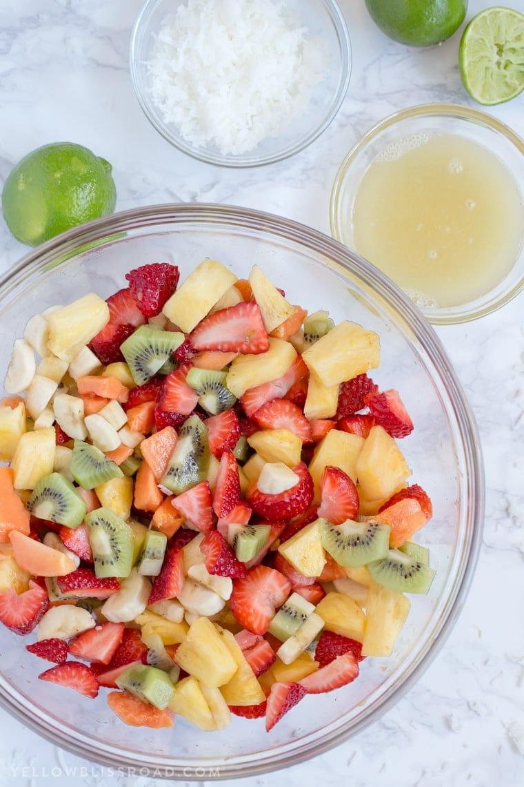 This Tropical Fruit Salad with Honey Lime Dressing is the light and refreshing and the perfect snack or side dish to any spring or summer meal.