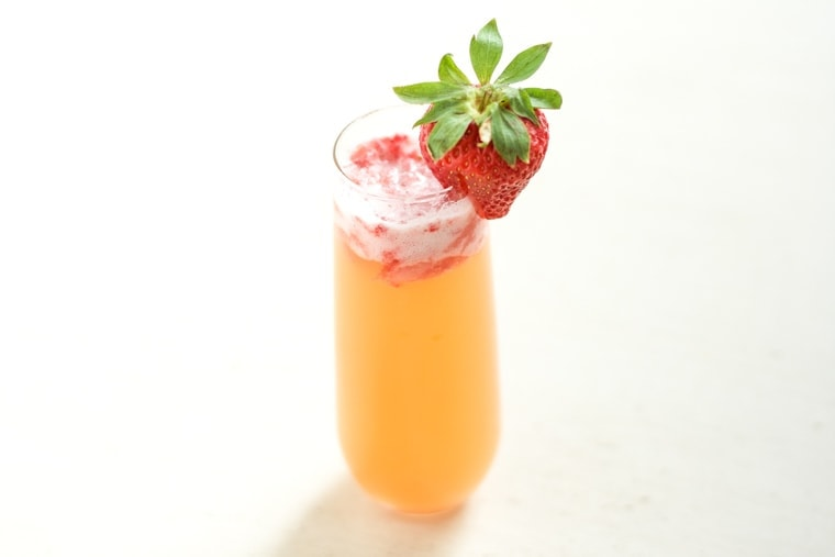 This Pineapple Strawberry Mimosa is crisp and refreshing and perfect for brunch! It's a stand-by classic with a sweet, fun twist.