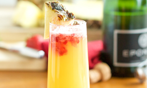 Pineapple Strawberry Mimosa- Nothing says brunch like the perfect mimosa! Try this twist on your classic mimosa and fall in love!