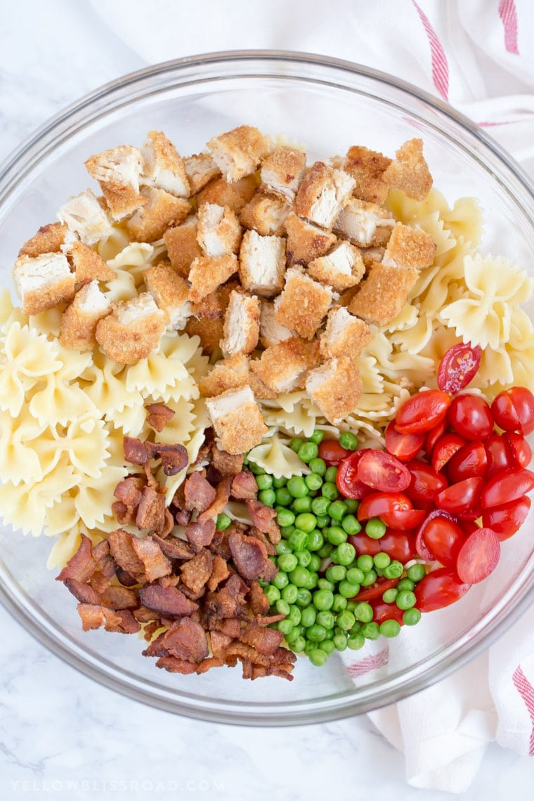 This Bacon Ranch Chicken Pasta Salad is cool and refreshing with a delicious, creamy Ranch flavored dressing, making it a summer staple for outdoor picnics and parties.