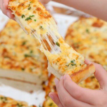 Sliced pieces of cheesy garlic bread