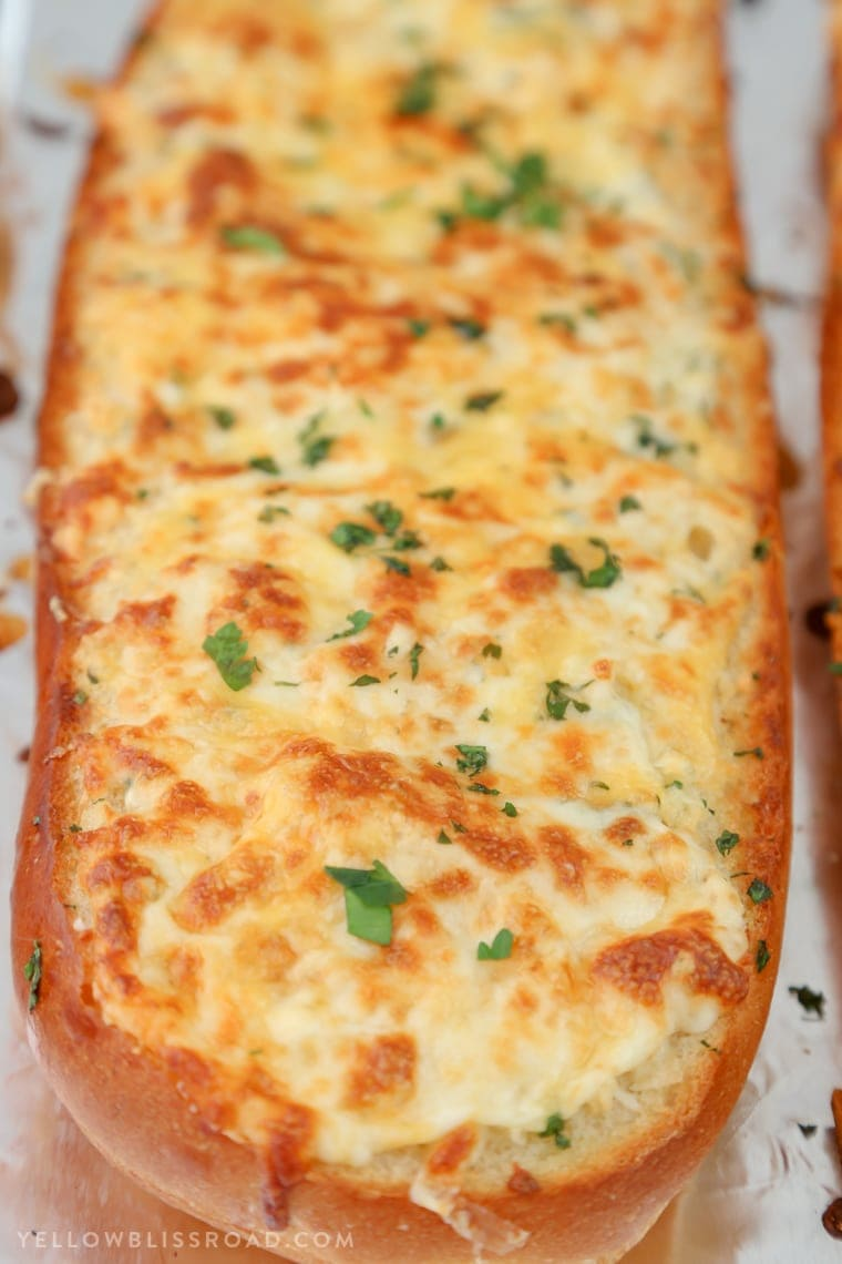 Cheesy Garlic Bread - Homemade Garlic Bread with tons of cheese and broiled on top.