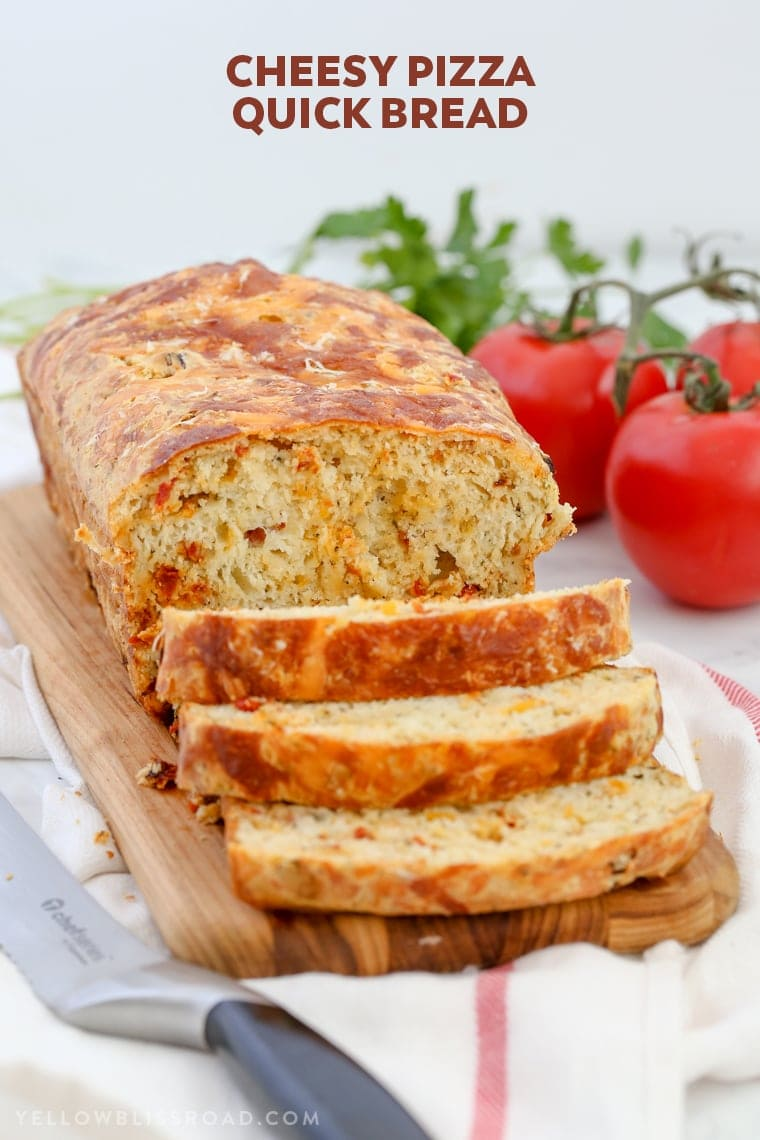 This Cheesy Pizza Bread is a savory quick bread recipe full of sun-dried tomatoes and three kinds of cheese! Great as a snack or with your favorite plate of spaghetti!