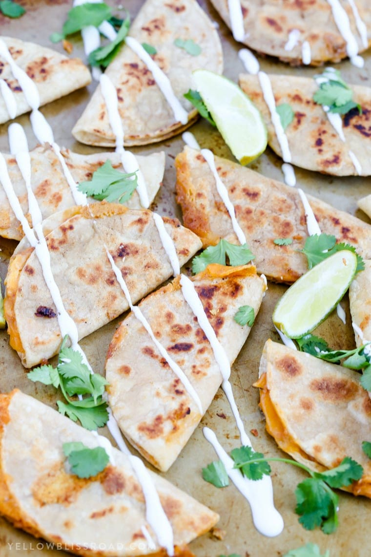 Mini Ranch Chicken Bean and Cheese Quesadillas are a fun appetizer party food or snack that's perfect for Cinco di Mayo!