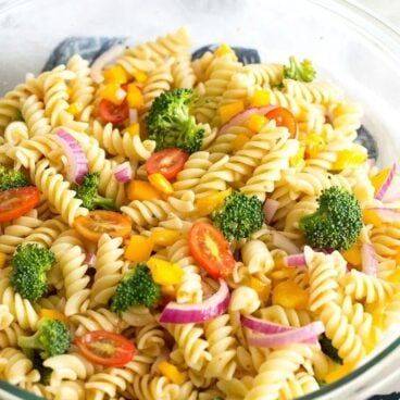 This Easy Vegetable Pasta Salad is one of my go-to summer recipes. It comes together in a snap and can be made ahead of time for a great menu addition!