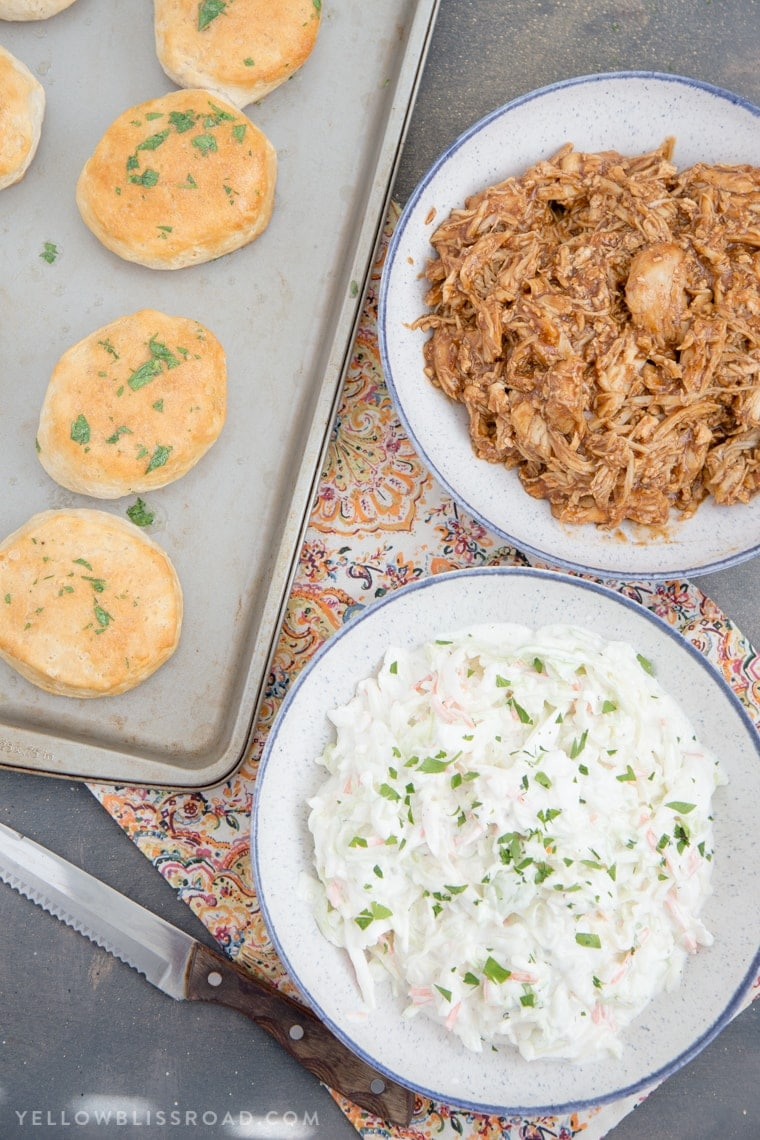 Barbecue Chicken Biscuit Sandwiches - Tender, flaky biscuits brushed with garlic butter and filled with tender BBQ chicken and a creamy, tangy coleslaw.