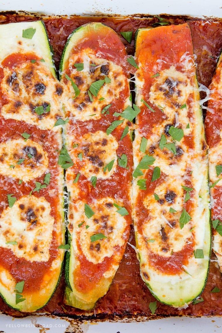 A close up of marinara zucchini boats
