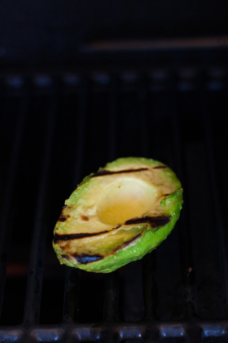 Velvety smooth avocados are filled with salsa and topped with melted cheese to make these Easy Grilled Avocados - the perfect summer appetizer or side dish!