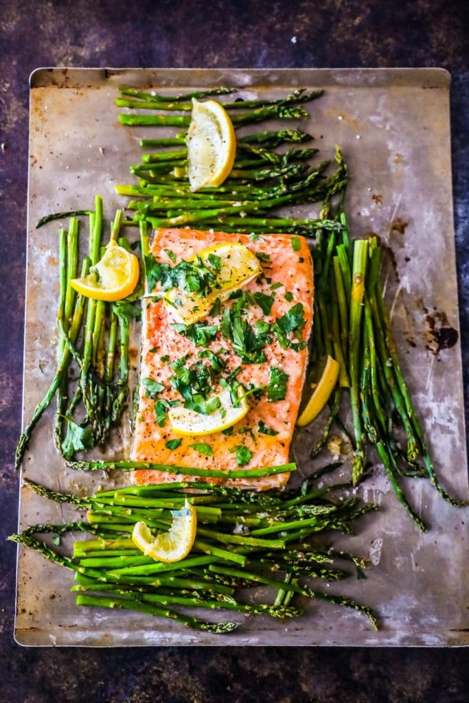 A close up of salmon with asparagus