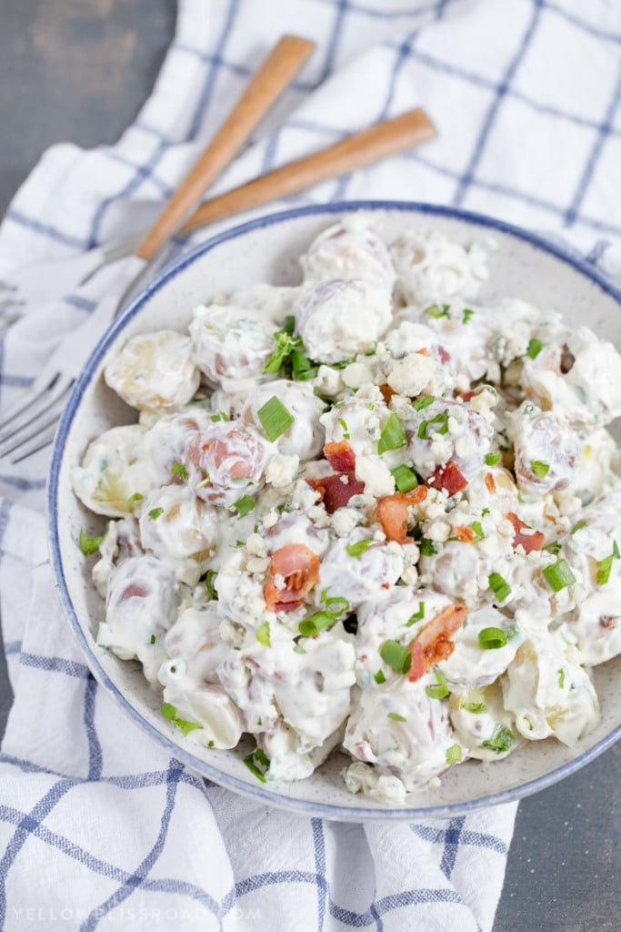 Red, White and Blue Cheese Potato Salad is creamy and savory and the perfect side dish for all of your summer picnics and barbecues!