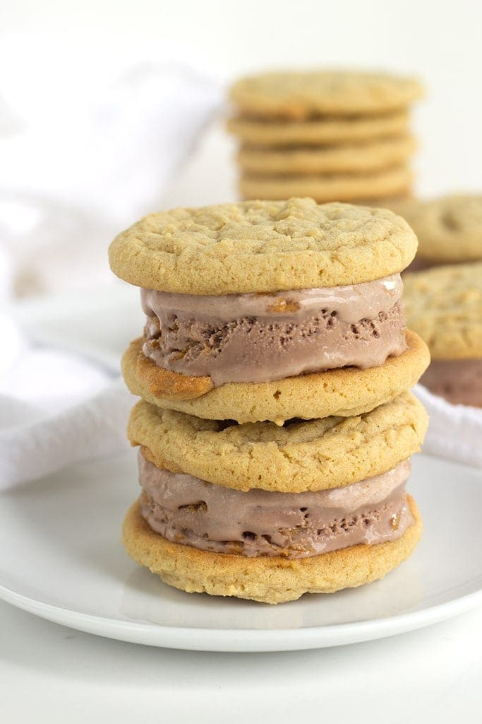 Peanut Butter Cookie and Chocolate Ice Cream Sandwiches are perfectly chewy homemade peanut butter cookies stuffed full of chocolate peanut butter ice cream.