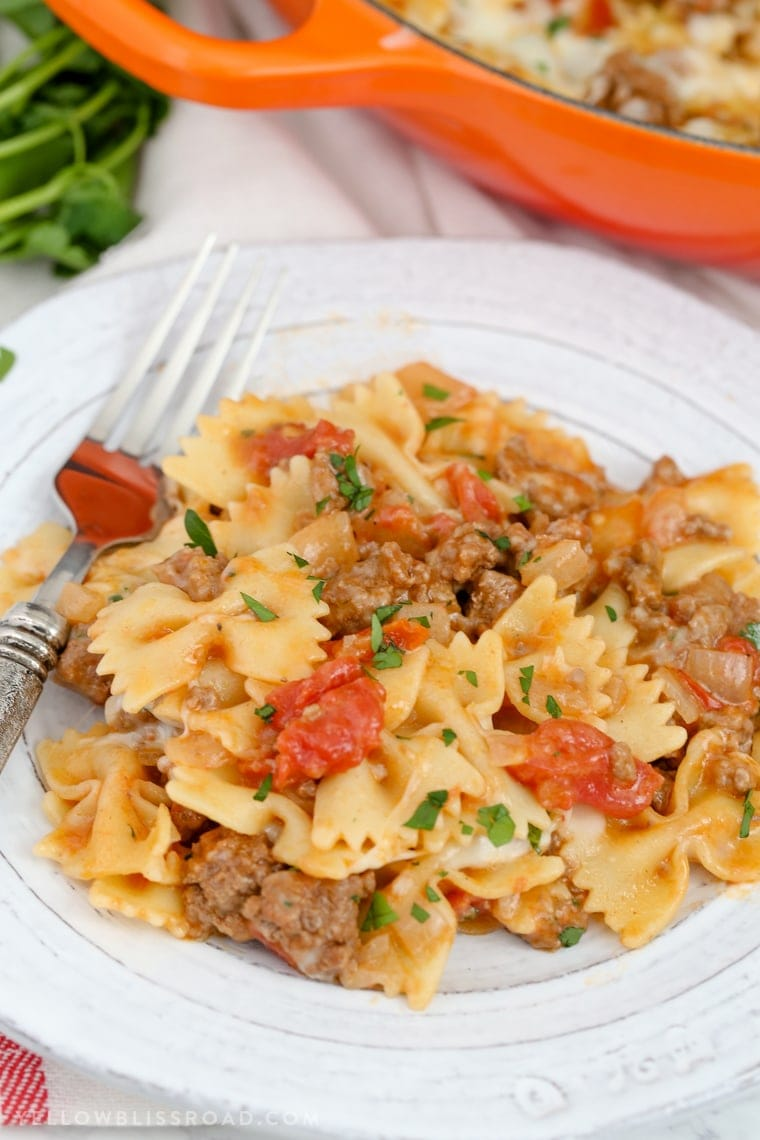 A plate of pasta with beef