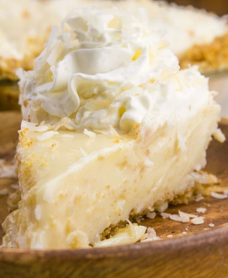 Tart, fruity and sweet this Coconut Key Lime Pie is one of the best and most loved dessert pies! This pie even had coconut IN the crust!
