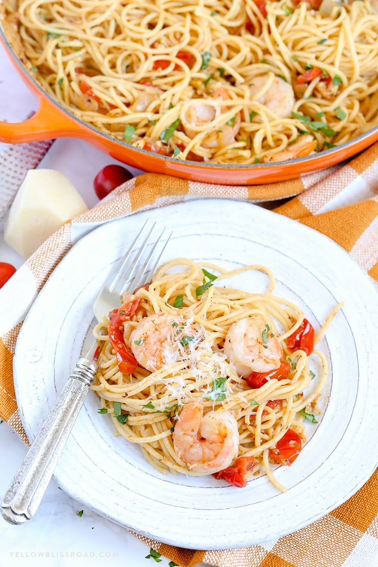 A plate of pasta and shrimp