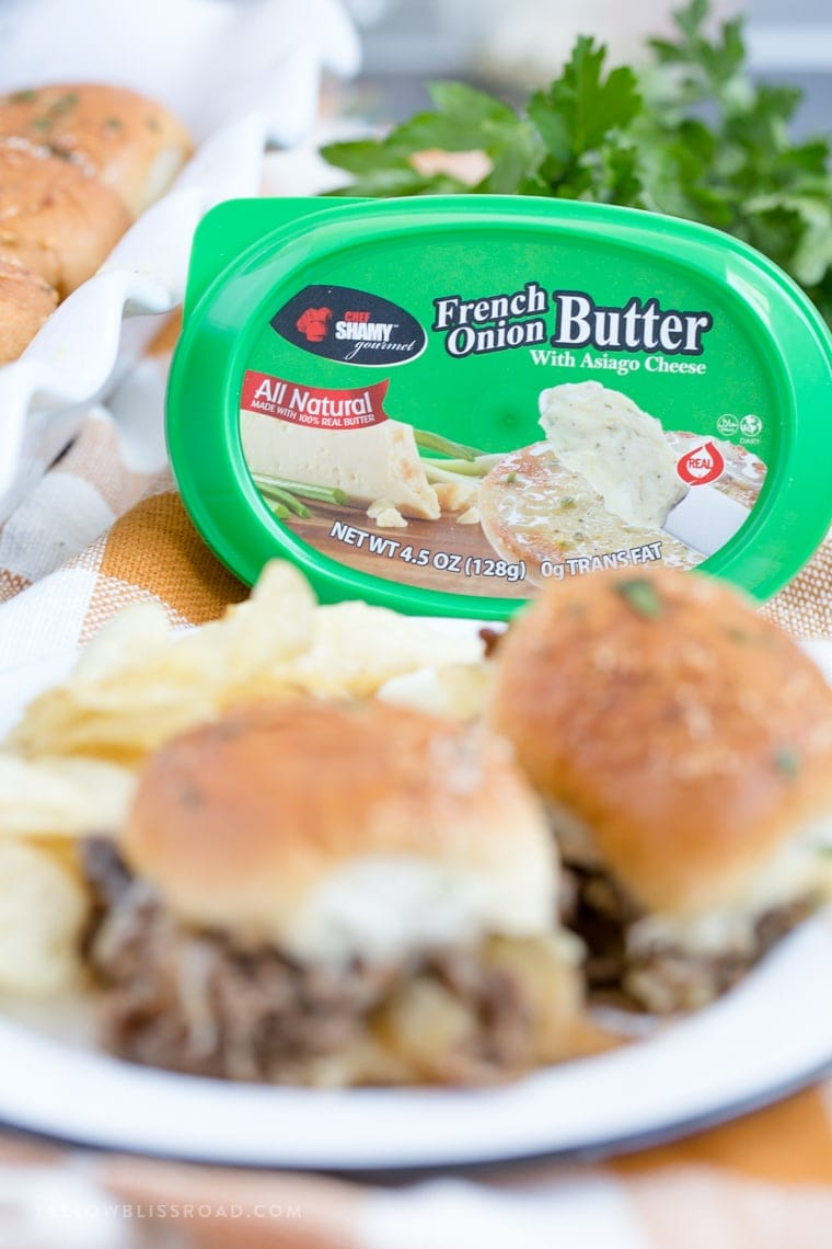 A close up of butter and sliders