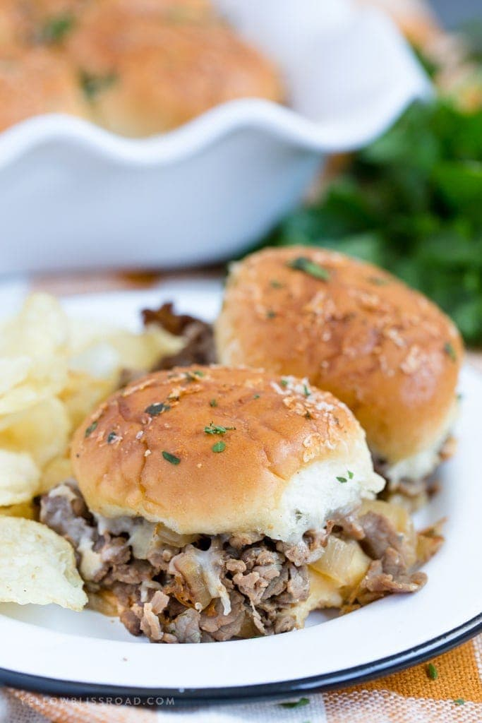 A close up of roast beef sliders
