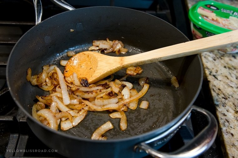A pan sauteing onions