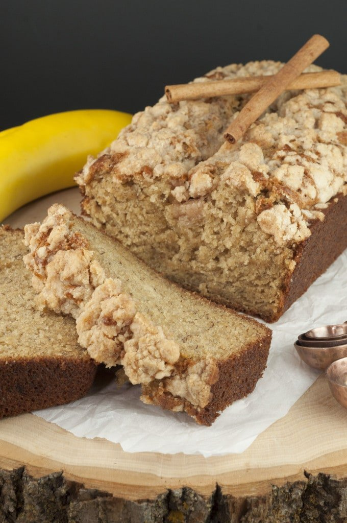 A loaf of banana bread on a cutting board