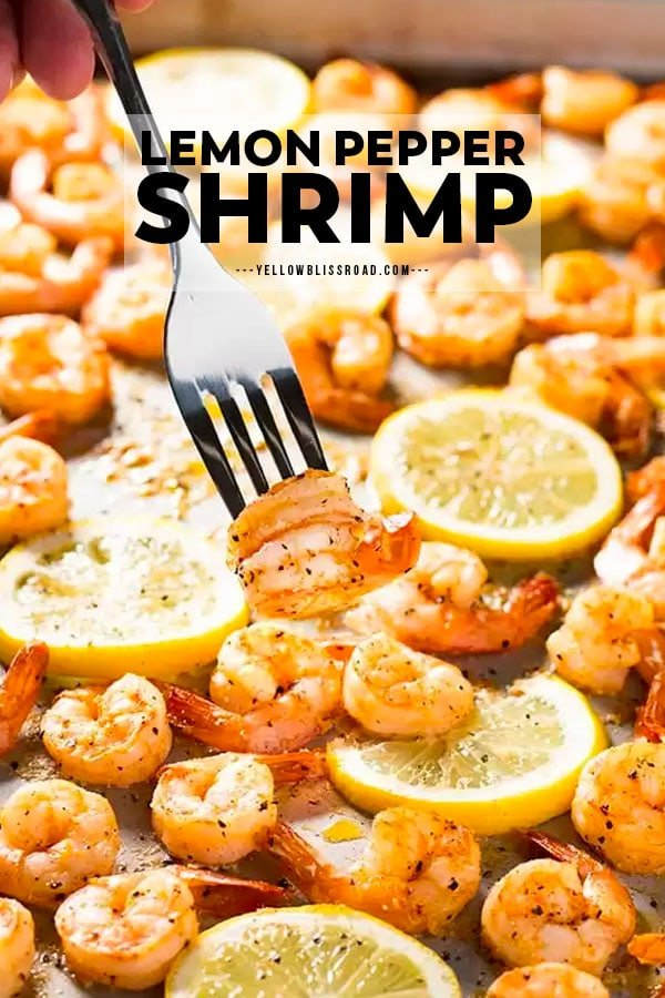 A for holding two shrimp above a sheet pan full of shrimp with lemon pepper
