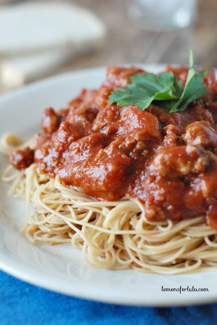 A plate of pasta and meat sauce