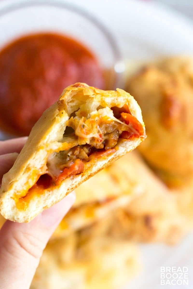 These Mini Sausage and Pepperoni Calzones are the best finger food! They're great for parties, or pack them in your lunch!