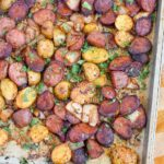 A sheet pan filled with with Potato and Sausage