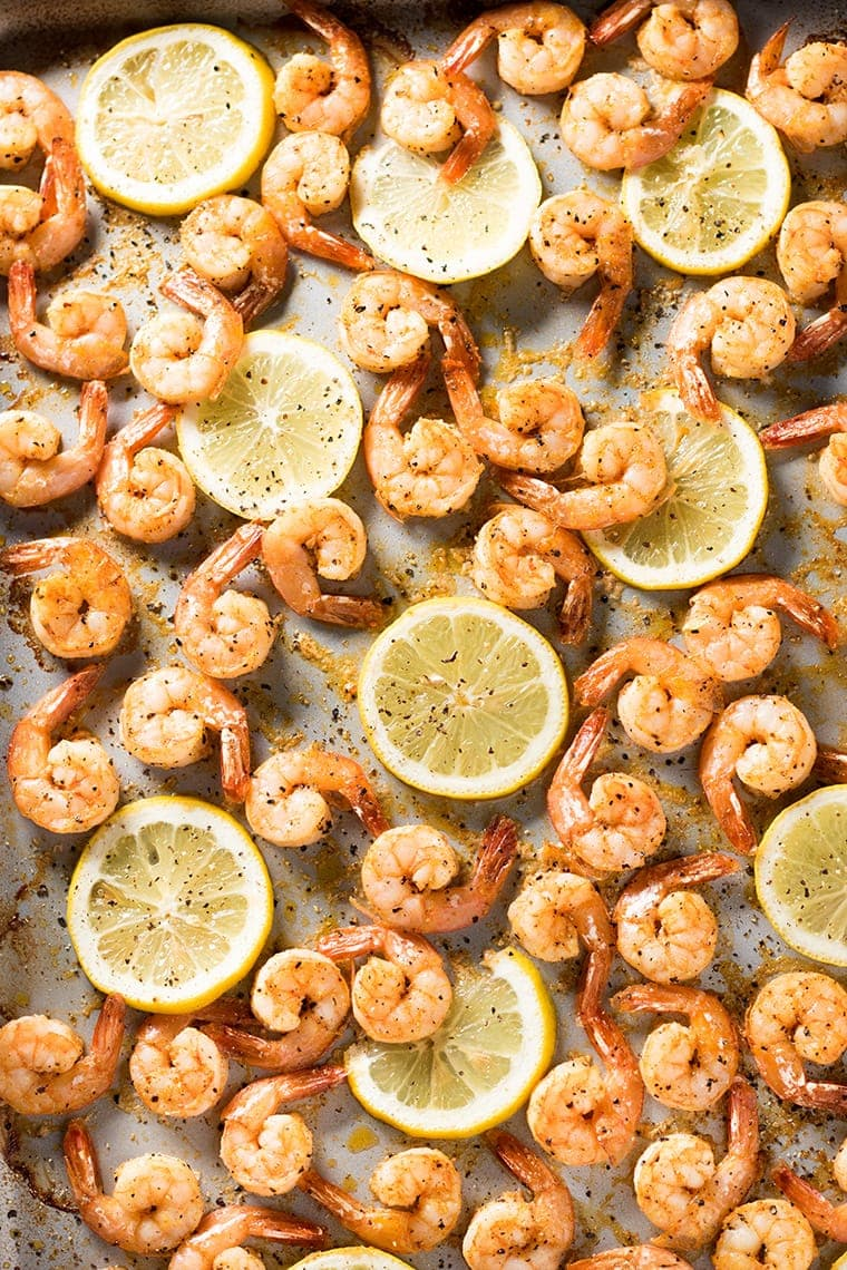 Sheet Pan Lemon Pepper Shrimp with slices of lemon scattered throughout