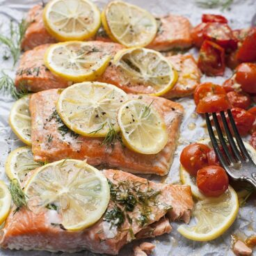 Close up of roasted salmon and tomatoes