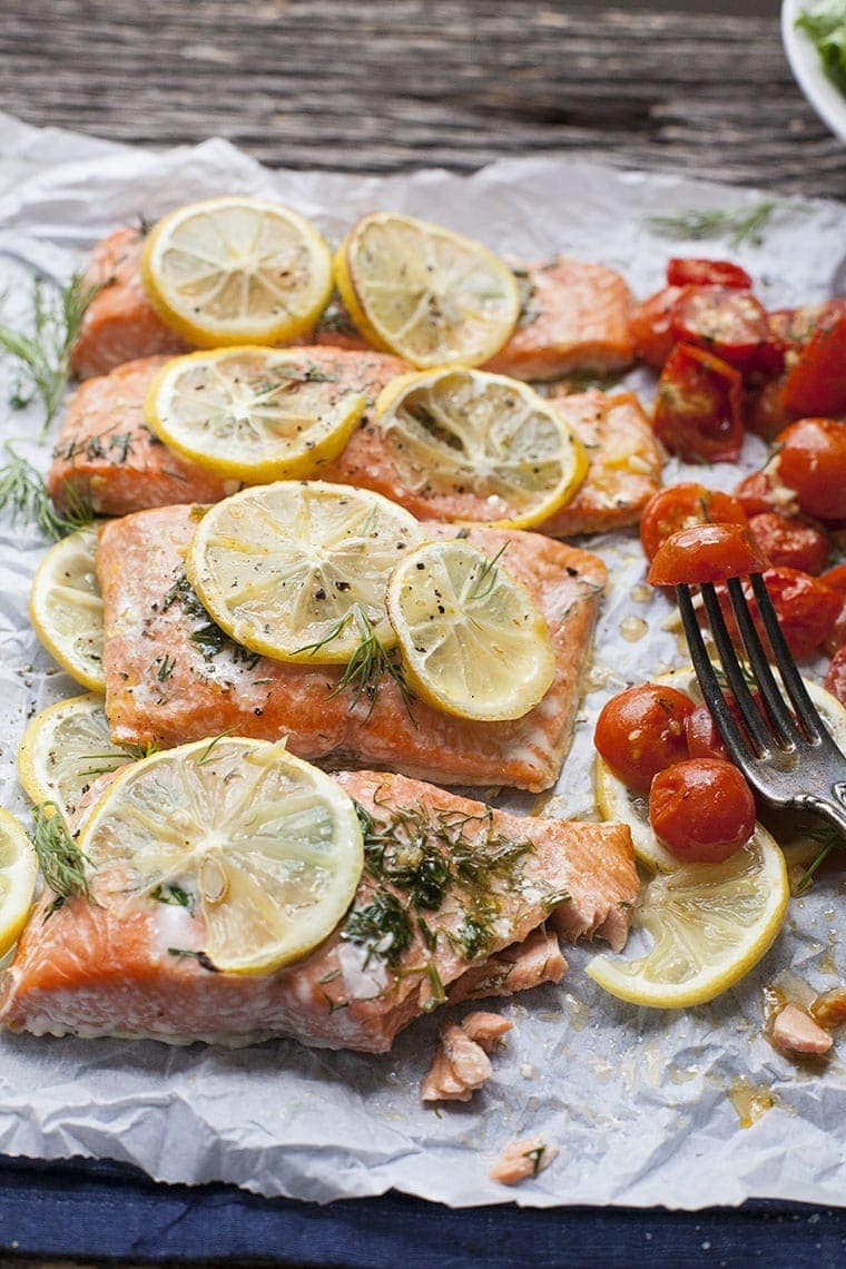 Sheet Pan Lemon Dill Salmon with Roasted Tomatoes is a weeknight dinner dream but still impressive enough for a special occasion.