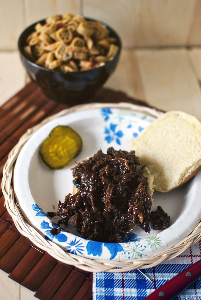 A plate of shredded beef, bread