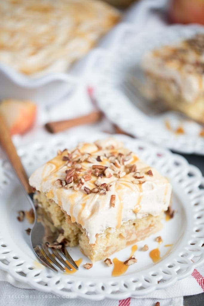 Caramel Apple Pie Poke Cake with cinnamon caramel cream cheese frosting.