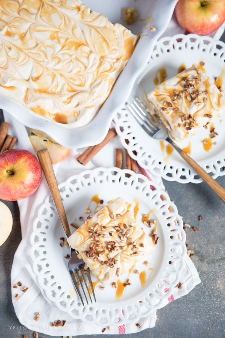 Caramel Apple Pie Poke Cake with a sweet cinnamon caramel cream cheese frosting.