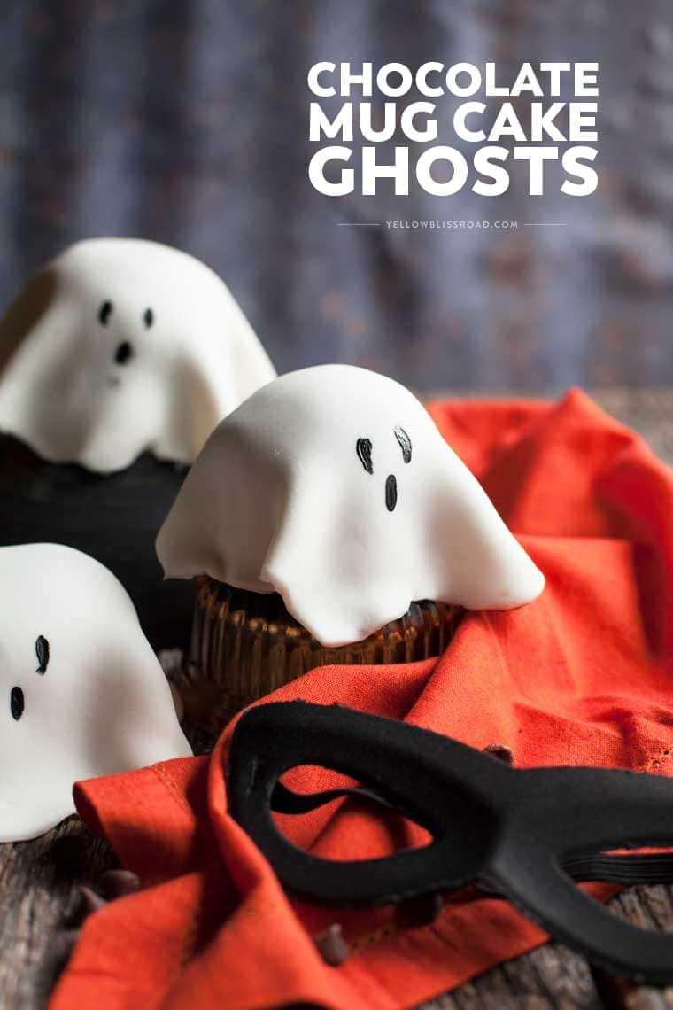 "Such a fun Halloween Treat! Microwave Chocolate Mug Cakes topped with white fondant ""ghosts."""