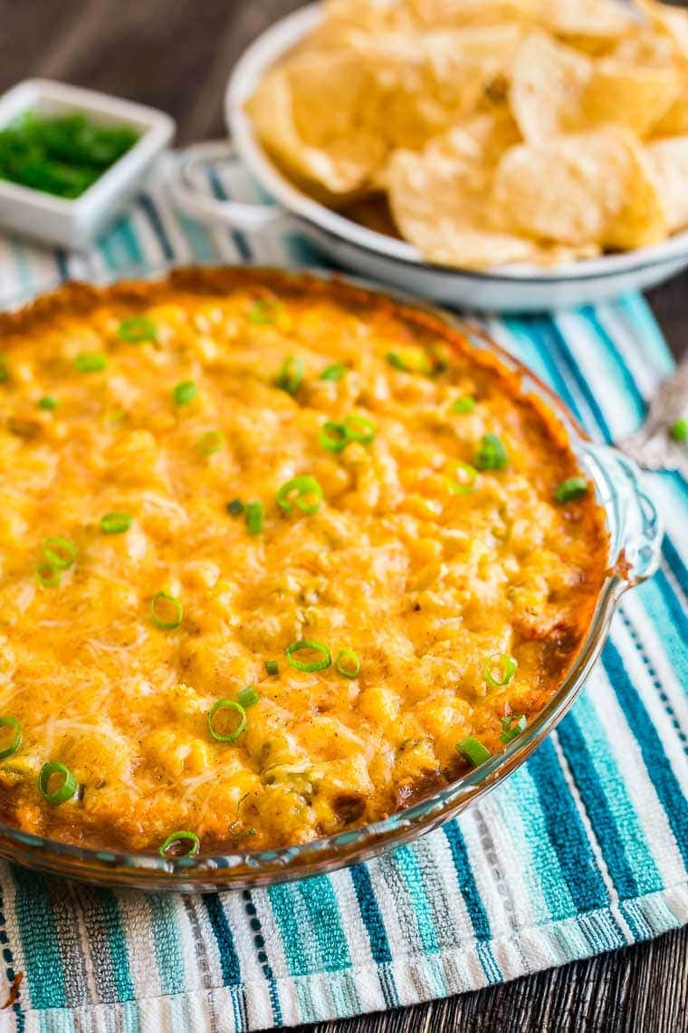 Cheesy Hot 7 Layer Dip - The ultimate appetizer for game day tailgating and parties!