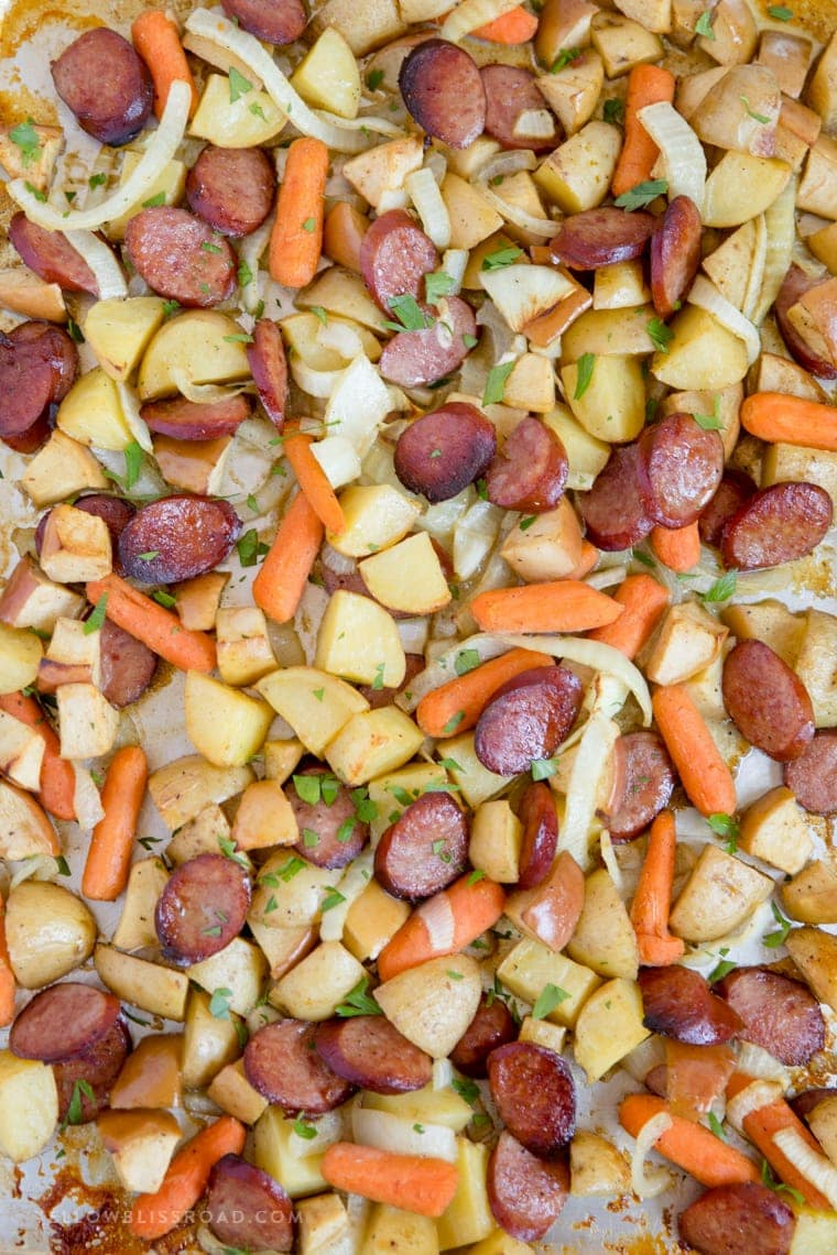 This Smoked Sausage & Apple Sheet Pan Dinner is a complete meal that's cooked all on one sheet pan for an easy weeknight dinner!