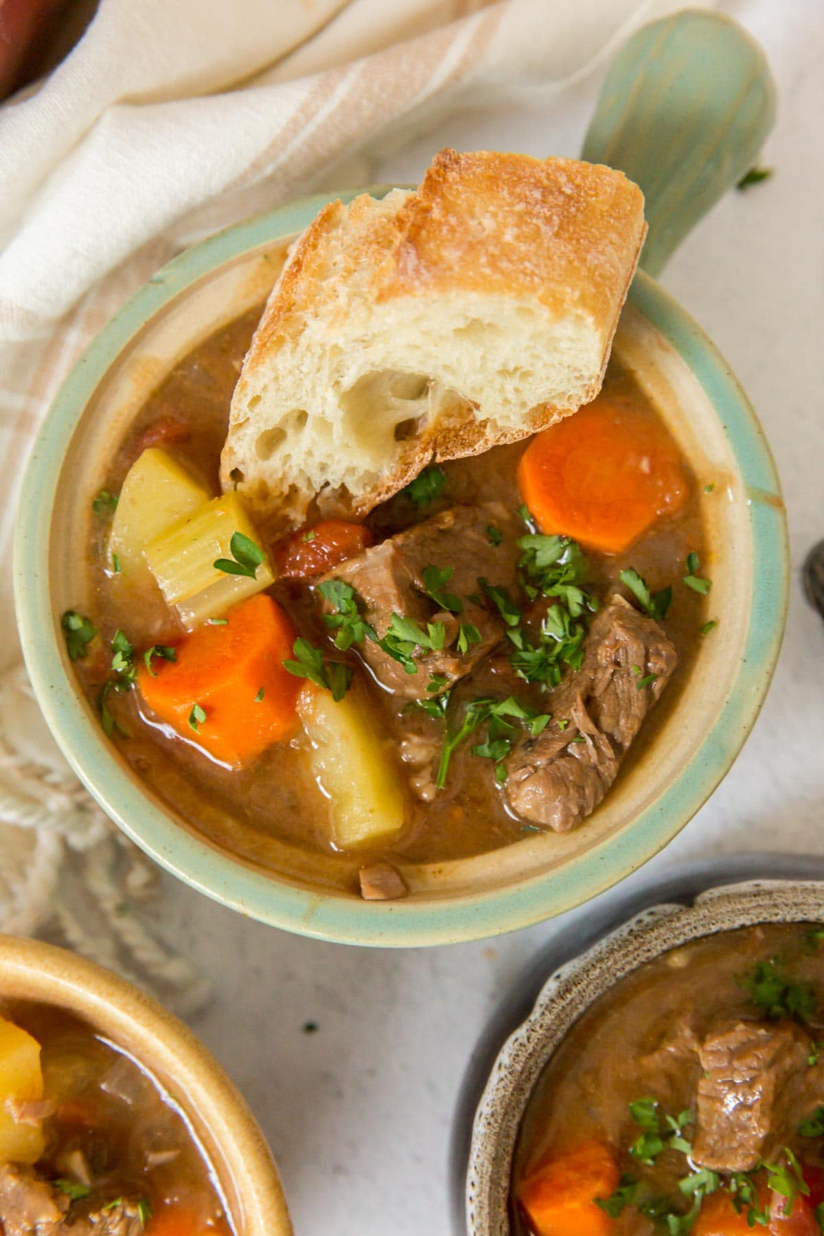 bowls of beef stew, bread