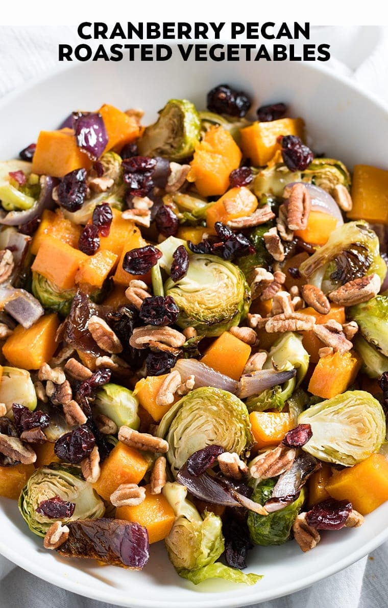 Cranberry Pecan Roasted Vegetables are cooked in a delicious maple cinnamon butter and will make an excellent Thanksgiving side dish to any holiday meal!