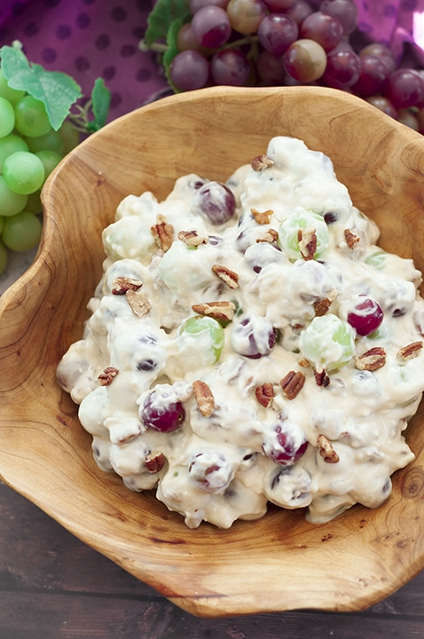 A dish with grape salad