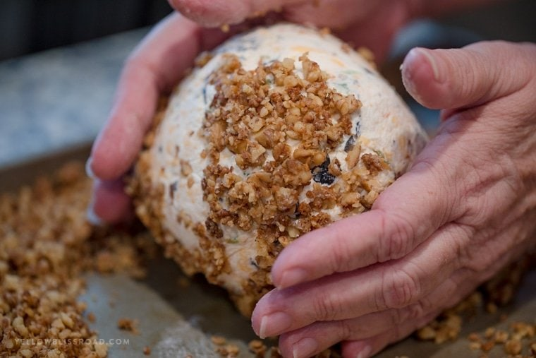 Olive cheese ball rolled in toasted parmesan walnuts