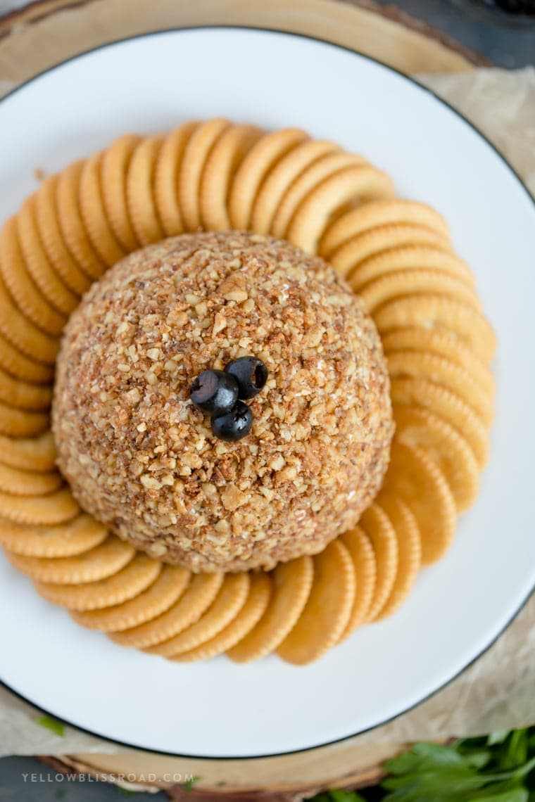 How to make a cheese ball appetizer with olives, walnuts and cheddar cheese