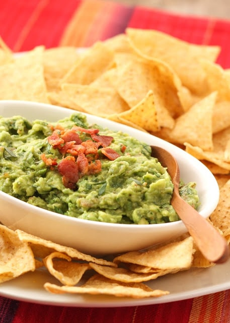 A dish of guacamole and chips
