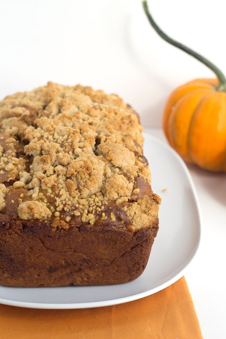 Pumpkin Bread with a Streusel topping - This dense, moist pumpkin bread full of spices and stopped with a streusel makes the perfect Fall quick bread! It's packed full of great flavor!