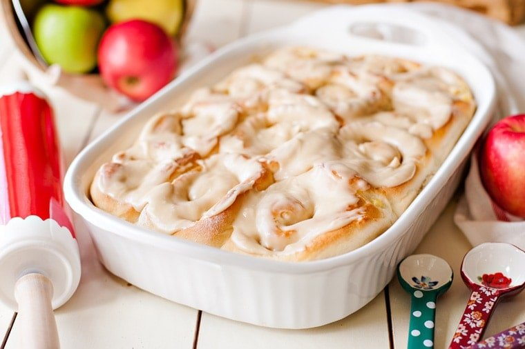 A white dish filled with Apple Cinnamon Rolls
